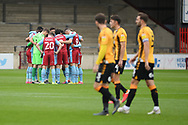 Scunthorpe United team huddle together pre-kick off during the EFL Sky Bet League 2 match between Scunthorpe United and Cambridge United at Glanford Park, Scunthorpe, England on 17 October 2020.