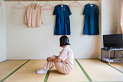 A (67) sits in the room she shares with other inmates at the Iwakuni Prison for women in Iwakuni, Yamaguchi prefecture, Japan.<br /> She is serving her first prison sentence for stealing a pair of trousers from a shopping arcade. She is a life-long housewife with a husband, two adult sons, and three grandchildren. She started shoplifting when she was in her mid-50s and kept at it over 20 times before being caught.
