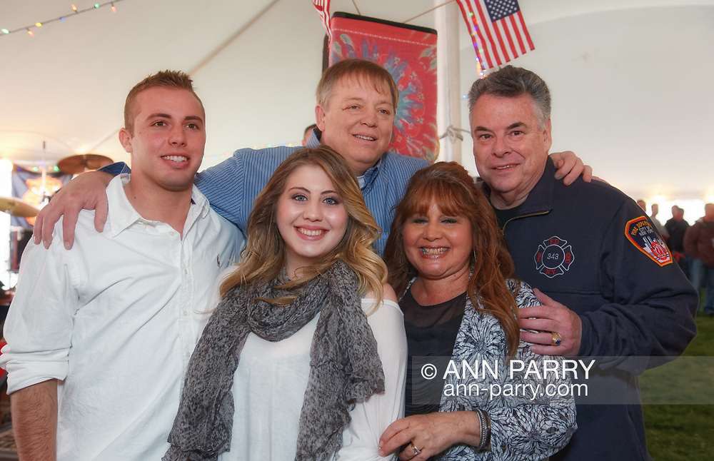 East Meadow, New York, U.S. March 31, 2012. Back row L-R, Firefighter RAY PFEIFER and Congressman PETE KING (Rep. - NY02), and, front row, son TERRENCE PFEIFER, daughter TAYLOR PFEIFER, and wife CARYN PFEIFER, pose for photo at fundraiser for Ray Pfeifer, an FDNY firefighter battling cancer after months of recovery efforts at Ground Zero following 9/11 2001 Twin Towers attack. Benefit was held at East Meadow Firefighters Benevolent Hall.
