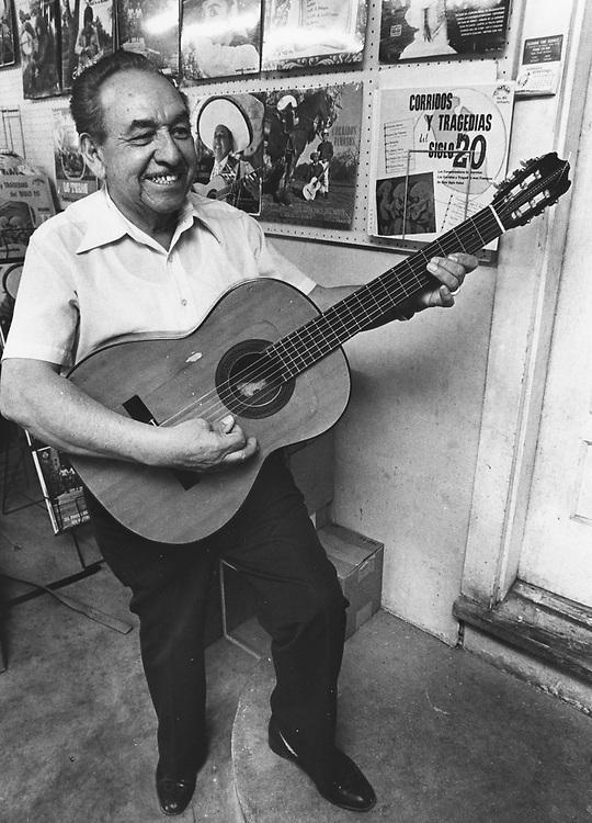 Hispanic music culture in Texas, meighborhood musician who plays in San Antonio, TX   guitar.