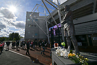 Football - 2020 / 2021 Sky Bet Championship - Play-offs - Semi-final, second leg - Swansea City vs Barnsley - Liberty Stadium.<br /> <br /> fans arrive for the first game with fans at swansea since the start of Coronavirus Act 2020. Ivor Allchurch statue with wreaths beneath it in foreground.<br /> <br /> COLORSPORT/WINSTON BYNORTH