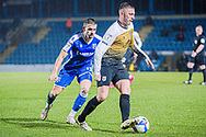 Crewe Alexandra midfielder Oliver Finney (14) keeps possession and the ball away from Gillingham Midfielder Olly Lee (11) during the EFL Sky Bet League 1 match between Gillingham and Crewe Alexandra at the MEMS Priestfield Stadium, Gillingham, England on 26 January 2021.