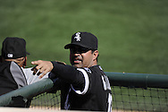 GLENDALE, AZ - MARCH 08:  Manager Ozzie Guillen #13 of Chicago White Sox gestures during the game against the Colorado Rockies on March 08, 2011 at The Ballpark at Camelback Ranch in Glendale, Arizona. The White Sox defeated the Rockies 9-8.  (Photo by Ron Vesely)