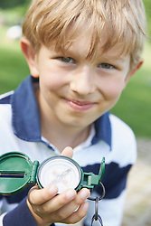 Close-up of a boy holding a navigational compass, Bavaria, Germany
