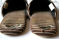Close up of slippers worn at the heal