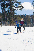 Mother trails her son while skiing at Alpine Meadows, Lake Tahoe, California