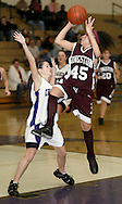 Kingston's Lynsey Timbrouck (45) leaps to the basket as Monroe-Woodbury's Kelli Gassert defends during a game in Central Valley on Feb. 10, 2006.