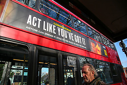 © Licensed to London News Pictures. 05/02/2021. London, UK. A man walks past government's 'Act Like You've Got It' awareness publicity campaign poster on the side of a bus in north London. The government has announced that everyone aged 50 and over will be vaccinated against coronavirus by May so that the lockdown restrictions could ease by the summer. Photo credit: Dinendra Haria/LNP