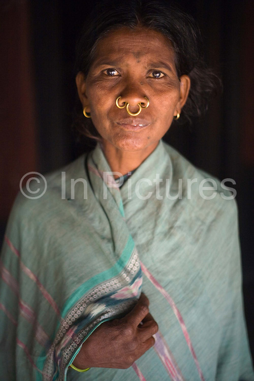 Dabu Limajhi, a Dongria Kondh tribal woman in Kankasarpa villageg in her house. The Dongria Kondh are a protected 'Scheduled' Caste of Original (aboriginal) people that practice animism and live a settled rural life. Their deity is a mountain from which a mining company, Vedanta is seeking to extract bauxite which will largely destroy the mountain and the Kondh's traditional way of life.
