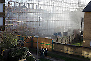 Residents return to see their devastated estate after an inner-city estate fire in south London. About 310 people were forced to leave their homes after the fire engulfed a wooden structure under construction in scaffolding at Sumner Road and Garrisbrooke Estate, Peckham, London at about 0430 AM. It spread to two blocks of maisonettes and a destroyed a pub. More than 150 firefighters tackled this unusually large and ferocious fire which injured ten people, including two police officers who received hospital treatment for minor injuries.  .