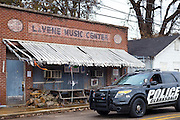 Police car passing Red's Lounge Blues Club entrance in Clarksdale, birthplace of the Blues, Mississippi, USA