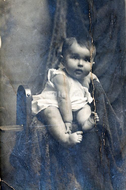 surface cracked vintage studio portrait of a toddler