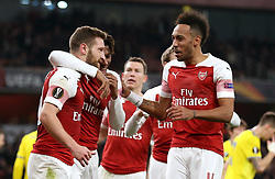 Arsenal's Shkodran Mustafi (left) celebrates his side's second goal of the game with teammates Alex Iwobi and Pierre-Emerick Aubameyang (right)