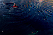 Journalist Michael E. Sprengelmeyer takes a dip in the waters of the Blue Hole in Santa Rosa New Mexico. - Steven St. John for New Mexico Magazine