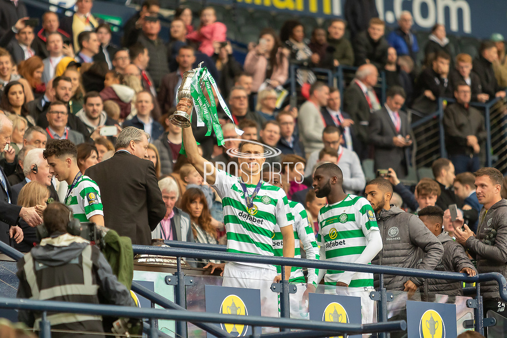 Jozo Simunovic holds the William Hill Scottish Cup aloft following their victory today in the William Hill Scottish Cup Final match between Heart of Midlothian and Celtic at Hampden Park, Glasgow, United Kingdom on 25 May 2019.