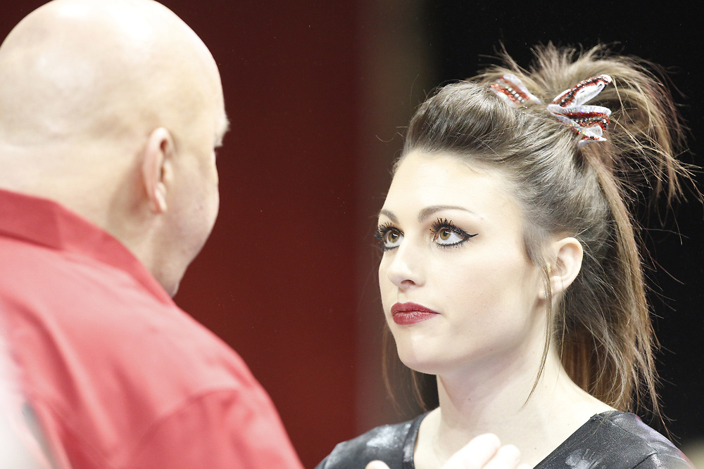 Madison McConkey talks to head coach Dan Kendig prior to competing on the uneven bars against Minnesota at the Bob Devaney Sports Center in Lincoln, Neb., on Feb. 12, 2016. Photo by Aaron Babcock, Hail Varsity