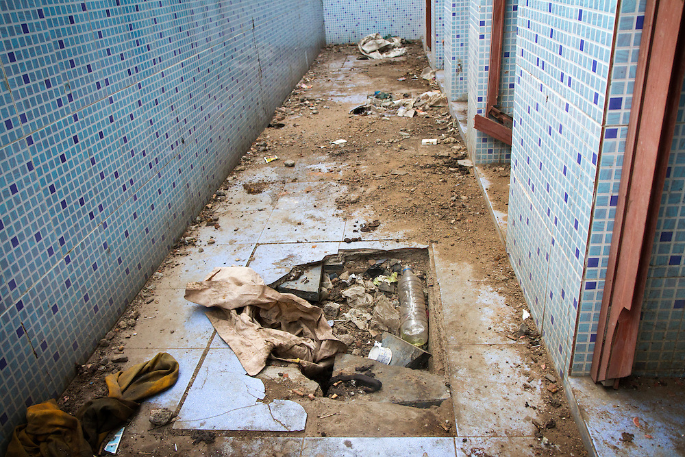 Government built bathrooms lay in disrepair after years of neglect in a slum in Chennai, India.