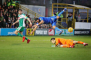 AFC Wimbledon midfielder Andy Barcham (17) is upended by Plymouth goalkeeper Matt Macey but no penalty during the EFL Sky Bet League 1 match between AFC Wimbledon and Plymouth Argyle at the Cherry Red Records Stadium, Kingston, England on 26 December 2018.