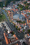 Nederland, Utrecht, Oudewater, 19-09-2009; 17e eeuws stadje met beschermd stadsgezicht aan de Hollandsche IJssel, bekend van onder andere de Heksenwaag en de Hervormde Grote of Sint-Michaëlskerk (hallenkerk, 15de eeuw). Langs de IJssel havendag met gondelvaart, nautische markt.17th century town, known for its Witch Weighhouse and its Reformed Great Church of Saint Michael (church hall, 15th century.luchtfoto (toeslag), aerial photo (additional fee required).foto/photo Siebe Swart