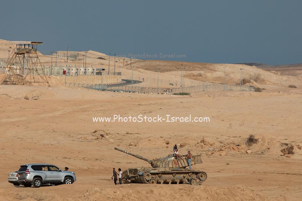 Deserted rusting tank in the Judaean desert, West Bank, Israel