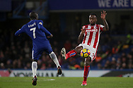 N'golo Kante of Chelsea and Saido Berahino of Stoke city  battle for the ball .<br /> Premier league match, Chelsea v Stoke city at Stamford Bridge in London on Saturday 30th December 2017.<br /> pic by Kieran Clarke, Andrew Orchard sports photography.