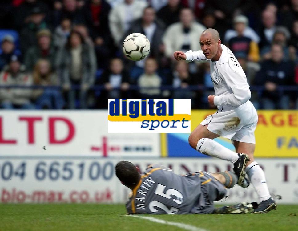 Photo. Aidan Ellis.<br />Bolton Wanderers v Everton.<br />FA Barclaycard Premiership.<br />29/11/2003.<br />Bolton's Stelios Giannakopoulos beats Nigel Martyn but the shot goes just wide