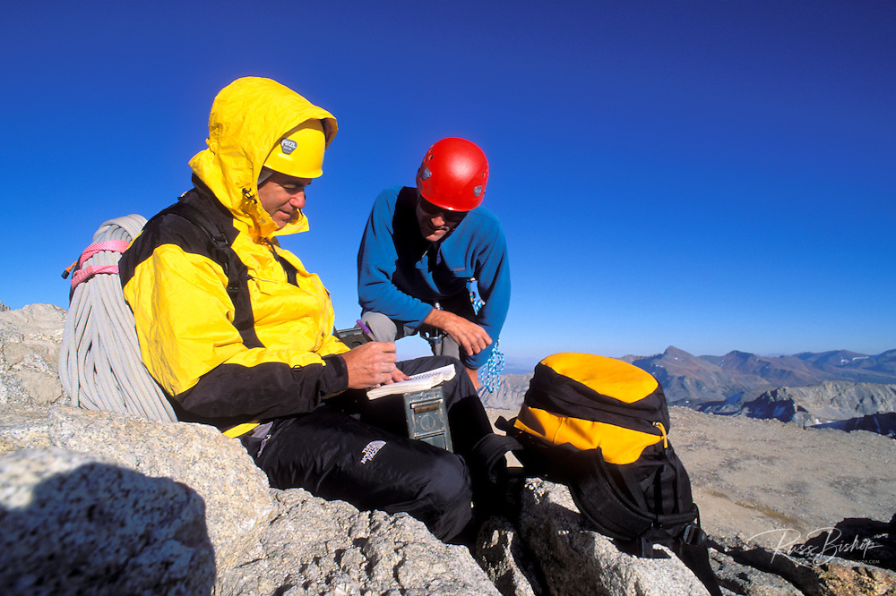 Climbers signing the register on the summit of Mount Conness, Tuolumne Meadows area, Yosemite National Park, California