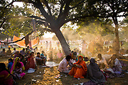 During the month long Sonepur animal fair, pilgrims sleep, rest and eat in the open air, Bihar, India.
