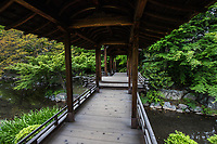 """Kaito-ro Bridge at Shosei-en - Kaito-ro, a covered bridge connects the north edge of Engetsu-chi pond and the north island at Shosei-en Garden - designed as a retreat for the chief priest Sen'nyo.  Shosei-en is also called Kikoku-tei """"Orange Mansion"""" because it was once surrounded by orange groves. The garden is a Chisen-Kaiyu-Shiki teien that is a pond garden, or strolling garden with buildings such as tea-ceremony houses and bridges  throughout the grounds."""