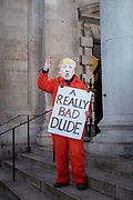 A man wearing an orange prison outfit and a Donald Trump mask during a protest against U.S. President Donald Trump UK visit to attend the NATO North Atlantic Treaty Organisation summit on the 3rd December 2019 in London in the United Kingdom. Ahead of a British national election on 12th December 2019, Stop Trump Coalition and CND, Campaign for Nuclear Disarmament organised a protest to target a banquet at Buckingham Palace where Trump will dine with the Queen and other NATO leaders. The U.K. is hosting NATO summit to mark the military alliances 70th anniversary.