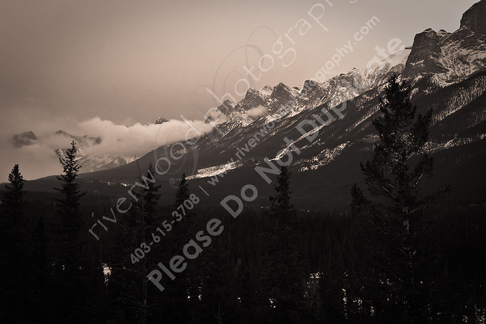 The rugged Rocky Mountains overlooking Canmore, Alberta...©2009, Sean Phillips.http://www.Sean-Phillips.com