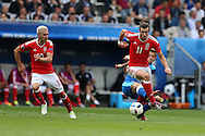 Gareth Bale of Wales in action ® as Aaron Ramsey of Wales (l) looks on. .Euro 2016, Wales v Slovakia at Matmut Atlantique , Nouveau Stade de Bordeaux  in Bordeaux, France on Saturday 11th June 2016, pic by  Andrew Orchard, Andrew Orchard sports photography.