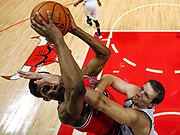 Chicago Bulls' Jimmy Butler (L) goes to the basket against Brooklyn Nets' Mirza Teletovic during the second half of their NBA basketball game in Chicago. REUTERS/Jim Young