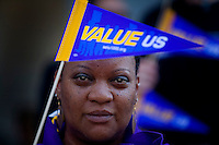 State worker Lajuan Andrews, protests Governor Schwarzenegger's proposal to cut state workers paycheck to the Federal minimum wage, during a protest at the State Capitol.