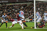 Andre Ayew of West Ham utd (2nd left) scores West Ham united's second goal of the game.  Premier league match, West Ham Utd v Huddersfield Town at the London Stadium, Queen Elizabeth Olympic Park in London on Monday 11th September 2017.<br /> pic by Kieran Clarke, Andrew Orchard sports photography.