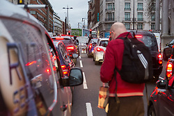 PICTURED: Traffic comes to a standstill as protesters block Oxford Street at Marble Arch. Demonstrators from the anti-pollution group Stop Killing Londoners cause traffic chaos for London commuters as they conduct a series of short roadblocks at Marble Arch stopping cars and buses from entering Oxford Street and Park Lane. Irate motorists accused them of creating more pollution than they were stopping, whilst the group said their objectives were long term. A leaflet handed out to motorists says the government is not doing enough to tackle the crisis costing 'taxpayers and the NHS £billions [sic] a year'. PLACE, January 29 2018. © Paul Davey