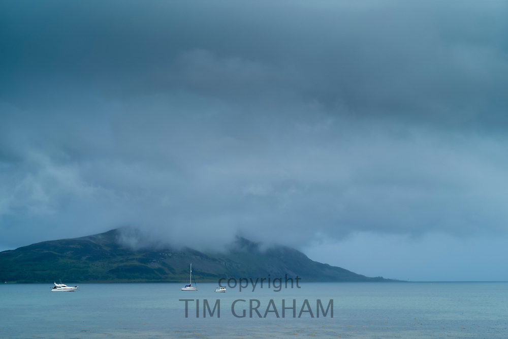 Misty grey scene - pleasure boats, yachts and cruisers moored in the bay at Lamlash on the Isle of Arran, Scotland