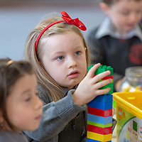Eili Hanrahan plays with the building blocks during her 1st day at Crusheen National School