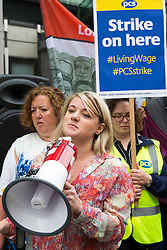 London, UK. 15 July, 2019. Jo Grady, newly elected General Secretary of the UCU trade union, addresses catering and cleaning staff belonging to the PCS trade union and outsourced to work at the Department for Business, Energy and Industrial Strategy (BEIS) via contractors ISS World and Aramark on the picket line outside the Government department after walking out on an indefinite strike for the London Living Wage, terms and conditions comparable to the civil servants they work alongside and an end to outsourcing.
