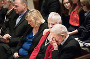 """June Shoen, second from right, glances at her brother Harold Gifford as they are overcome with emotion while listening to a Patsy Cline recording of """"Life's Railway to Heaven"""" during the memorial service for their brother Quentin Gifford Saturday May 12, 2018. The family always referred to the tune as """"Quentin's song."""" (Courtney Perry for MPR)"""