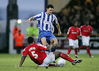 Photo: Paul Thomas.<br /> Chester City v Nottingham Forest. The FA Cup.<br /> 03/12/2005.<br /> <br /> Chester's Stewart Drummond takes on Wes Morgan.