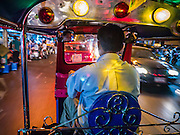 29 DECEMBER 2012 - BANGKOK, THAILAND: A tuk-tuk carries passengers in the Chinatown area of Bangkok, Thailand. Tuk-tuks are popular as taxis in many cities in Asia.        PHOTO BY JACK KURTZ