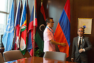 United Nations Protocol Assistant  Gavin Pan, left, holds the national flag of Armenia with fellow UN Protocol Assistant Roderick Santos, on the 38th floor of the United Nations.