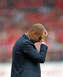 Football: Germany, 1. Bundesliga, SC Freiburg - FC Bayern Muenchen, Freiburg - 16.05.2015,<br /> Trainer Pep Guardiola (Muenchen) dejected<br /> <br /> © pixathlon<br /> <br /> +++ NED out !!! +++