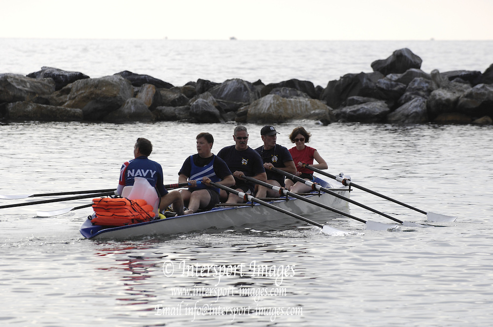 San Remo, ITALY, Mayflower Offshore Club crew, leaving the beach area to take part in the Sunday open competition,  2008 FISA Coastal World Championships. Sunday 19/10/2008. [Photo, Peter Spurrier/Intersport-images] Coastal Rowing Course: San Remo Beach, San Remo, ITALY Equipment,