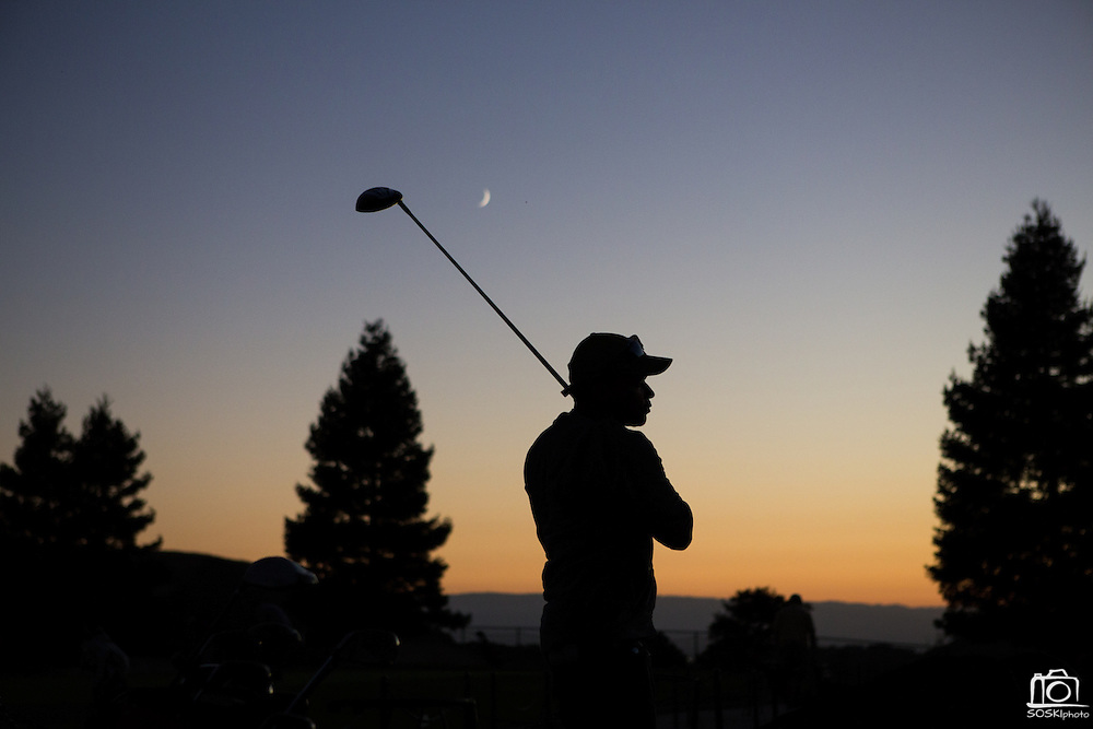 Lenis Mercedes practices his golf swing at the Spring Valley Golf Course's driving range at twilight on Sept. 18, 2012 in Milpitas, Calif.  The Spring Valley Golf Course sits in a beautiful valley in the Calaveras Hills.  Photo by Stan Olszewski/SOSKIphoto.