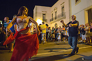 People dancing Pizzica in the street.