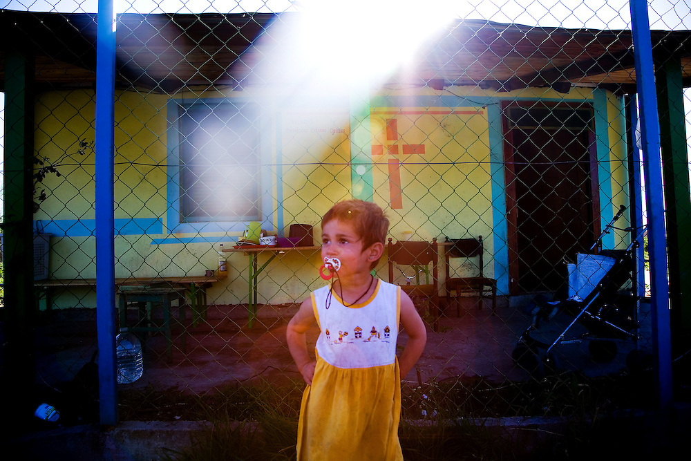 A young Roma (Gypsy) girl pauses in front of her family's compound on the outskirts of the northern Serbian industrial city of Pacevo.