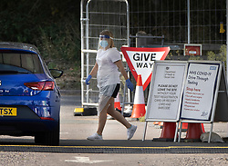 © Licensed to London News Pictures. 19/09/2020. Chessington, UK. A patient drives through a Covid-19 testing centre set up in the car park of Chessington World of Adventures south west of London. The Government have faced criticism over delays in getting tested for the COVID-19 strain of coronavirus. . Photo credit: Peter Macdiarmid/LNP