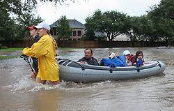 August 29, 2017 - Houston, Texas, U.S. - Residents of Katy's Grande Lakes ride in a boat to dry land during Hurricane Harvey. (Credit Image: © John Glaser/CSM via ZUMA Wire)